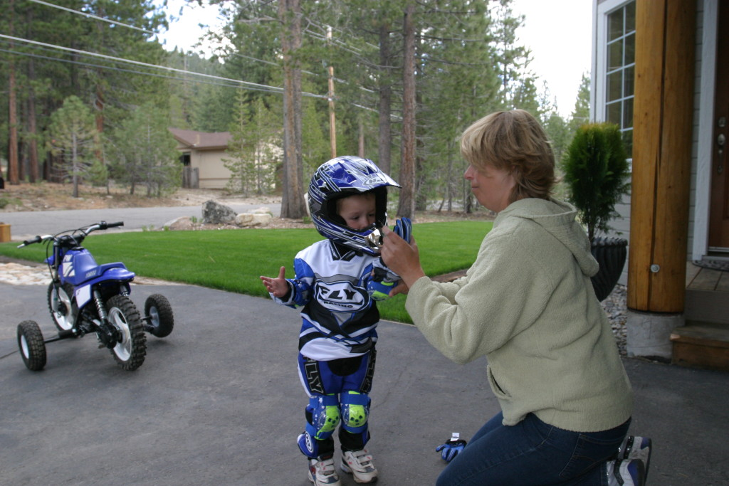 Lukas is getting suited up for riding at age 3.