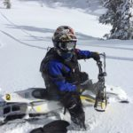 John in deep powder on his snowbike